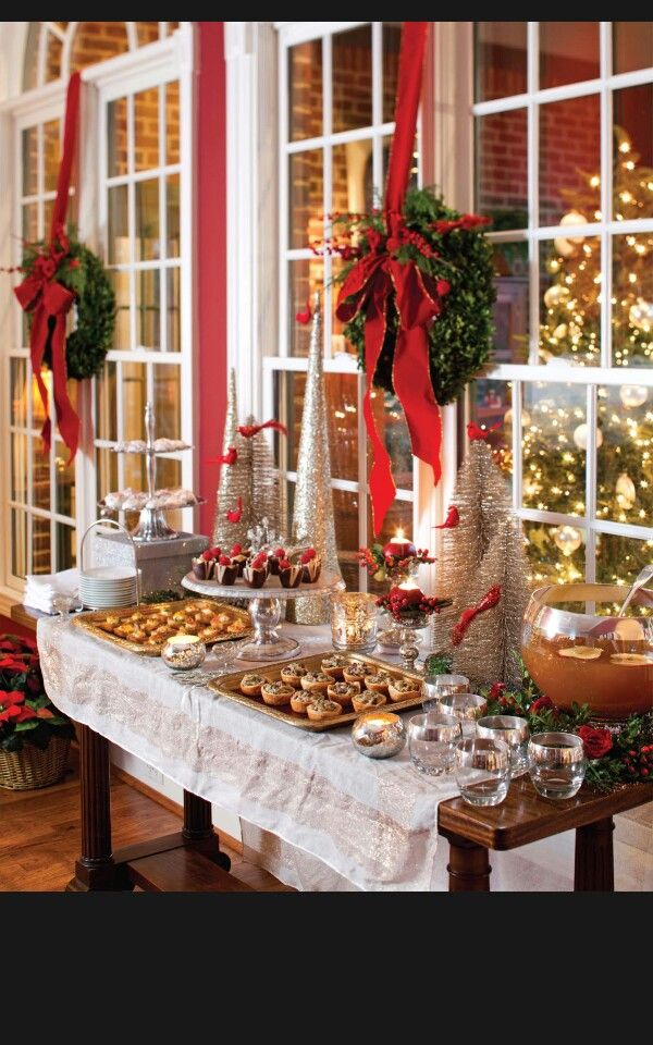 A well dressed holiday table dressed to a t Christmas table dressing